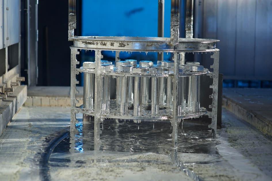 Hot-dip galvanization of a steel body. Galvanized steel is taken out of the zinc bath—Leist | Hot-dip galvanizing. (2021).